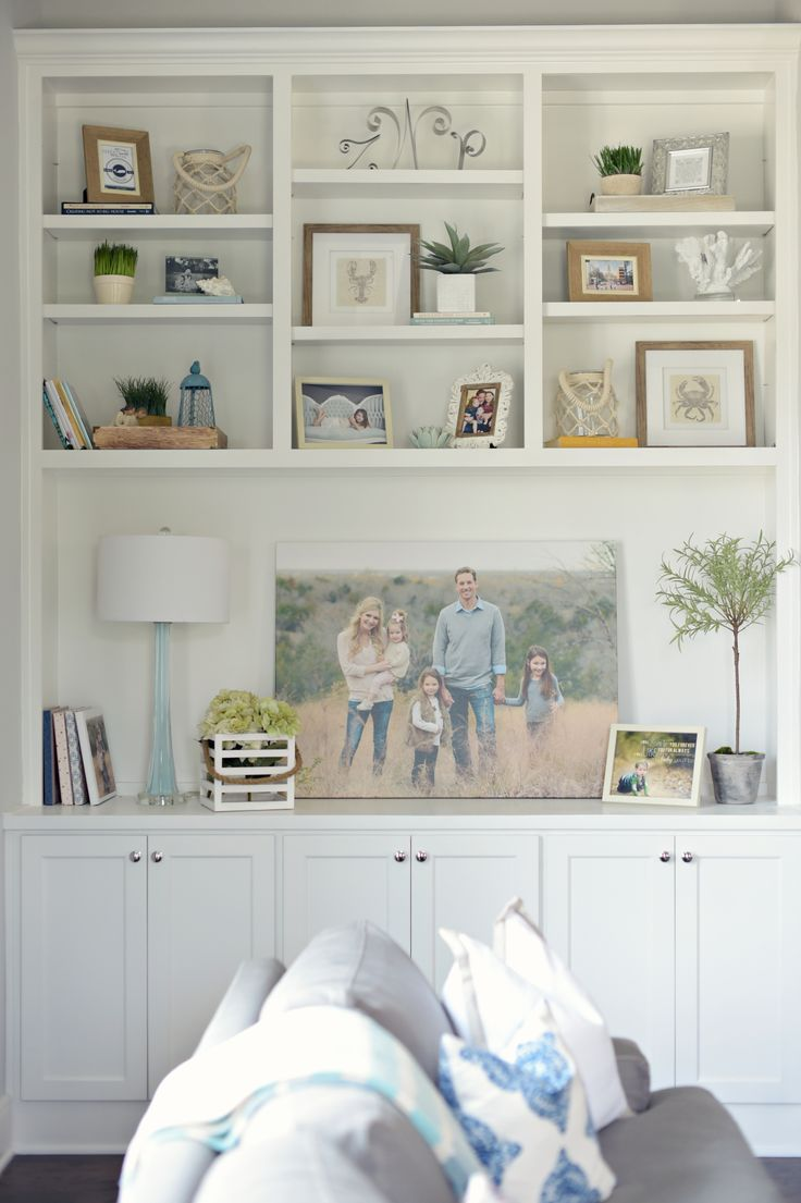 Family photo on stretched canvas in built in bookshelves