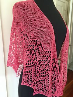 Marjorie is a shallow shawl that is perfect for that precious single skein of sock yarn. The solid stockinette body beautifully shows off subtle colour variations and the lace edging gives it an airy and pretty touch.