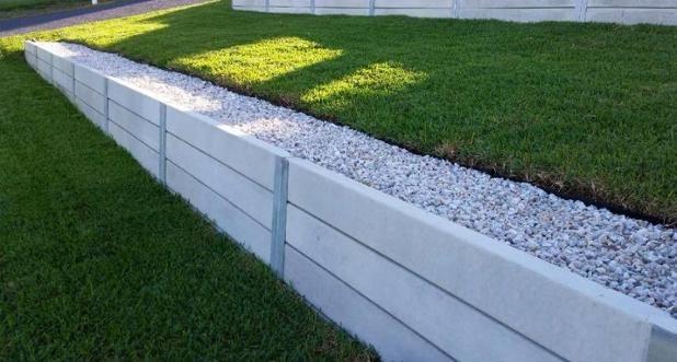 Ridgi Smooth Grey concrete sleeper retaining wall. Visit www.ridgi.com.au or find us on facebook!