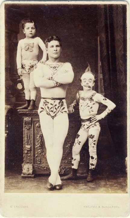 ca. 1870s, [carte de visite portrait of a performing family of circus acrobats and a clown], E. Gregson via Ebay
