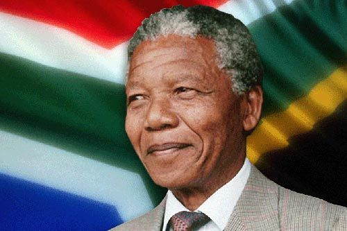 Trait: History In this photo we see Nelson Mandela. Nelson Mandela was one of the most famous people to South African history. Nelson Mandela was the first ever black president in South Africa and was sent to prison for 27 years.