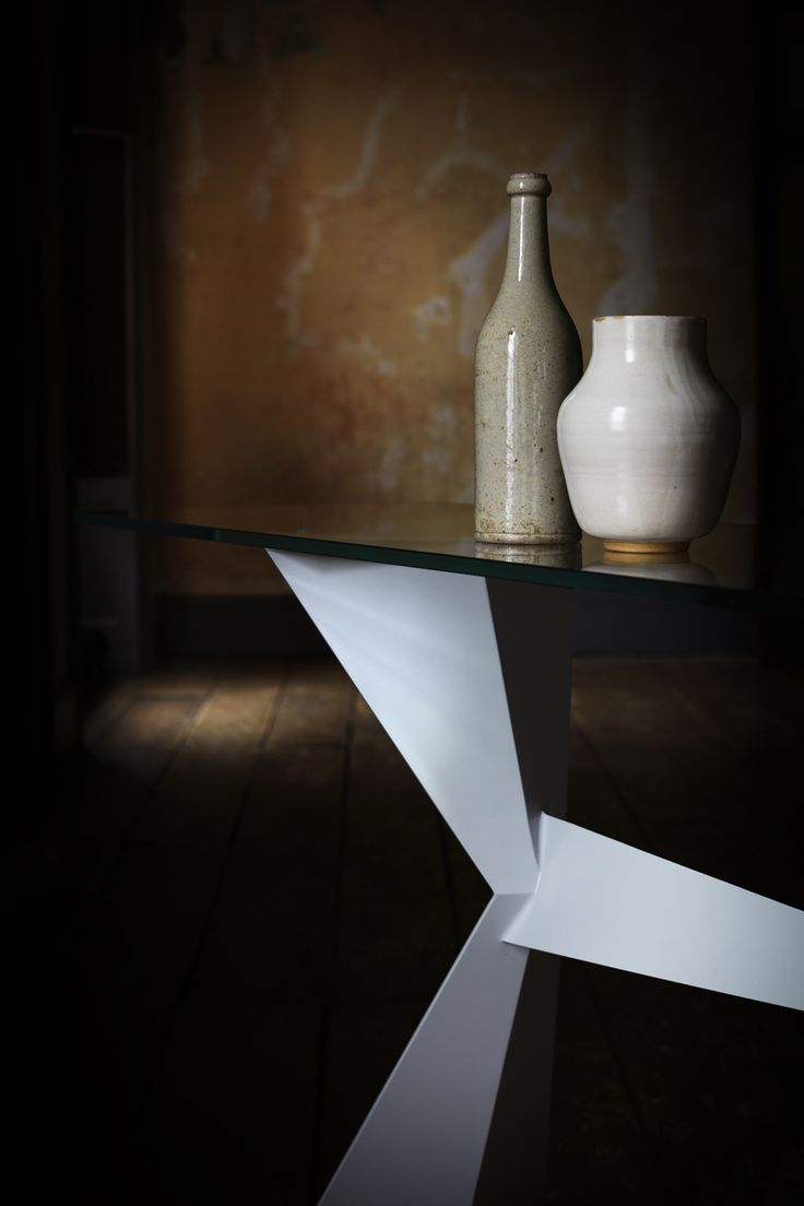Echo #console-table. Inspired by a trip to the Arctic, with crisp lines and sheer faces. Here the 'Cool Grey' finish and opti-clear glass suggest icy splendour.