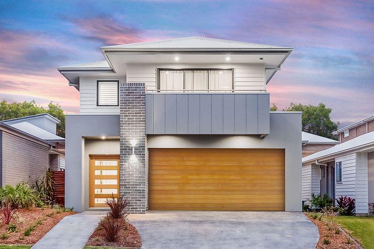 Double Storey Home Facade.  Timber-look garage.