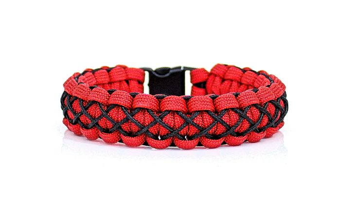 The Nexus Bracelet is one of the cool new paracord bracelet designs that I've stumbled across. I start out with a classic Solomon paracord bracelet, then stitch it with colorful micro cord in a very cool alternating X pattern, and finish it off with your choice of a side-release buckle or an adjustable stainless steel shackle. #ribbonandsteel #bracelet #paracord #custom