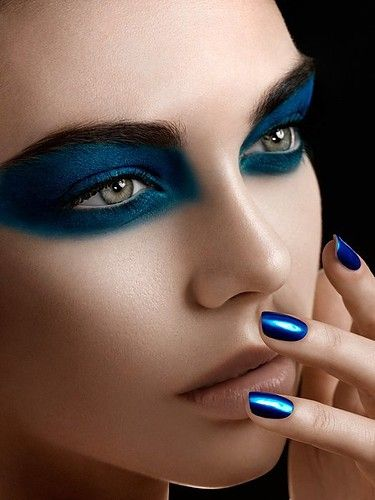 Electric blue makeup. love the nail polish too!