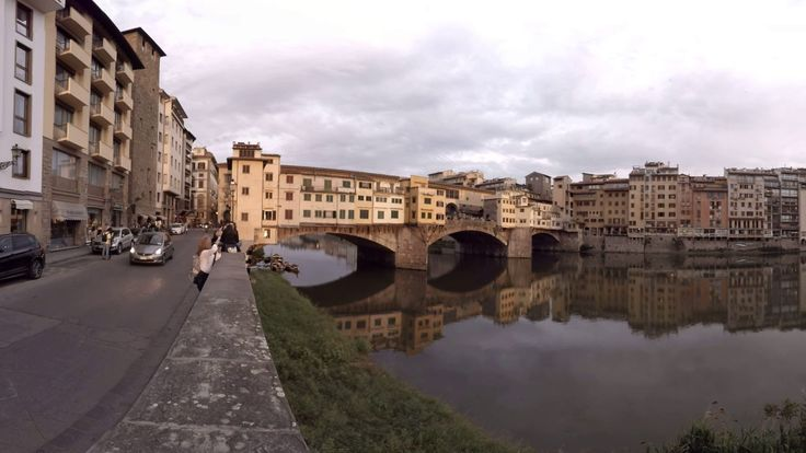 360 video: Vecchio Bridge, Florence, Italy / virtual reality / VR / Crossing the Arno River, this closed medieval bridge with arches is one of the oldest structures in Florence. The current bridge dates back to 1350 when it was rebuilt after a damaging flood.