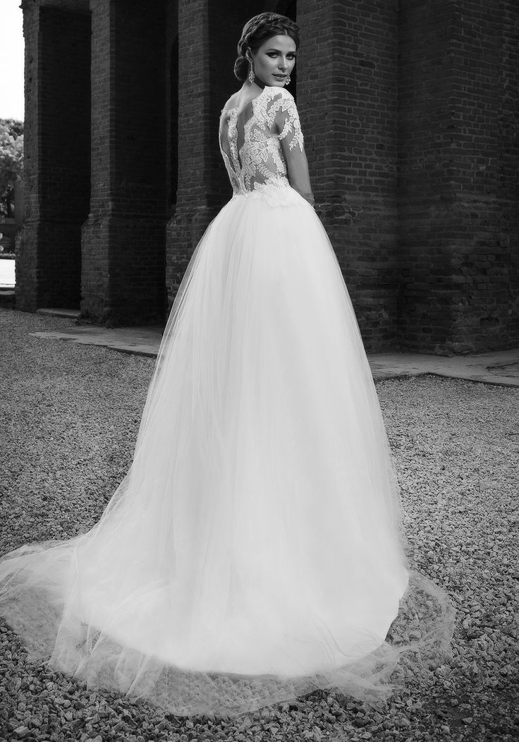 2016 ball gown wedding dress with long lace sleeves and high volume tulle skirt. See more of Vogue Addicted at our website www.biensavvy.eu or book an appointment for a showroom fitting at office@biensavvy.eu
