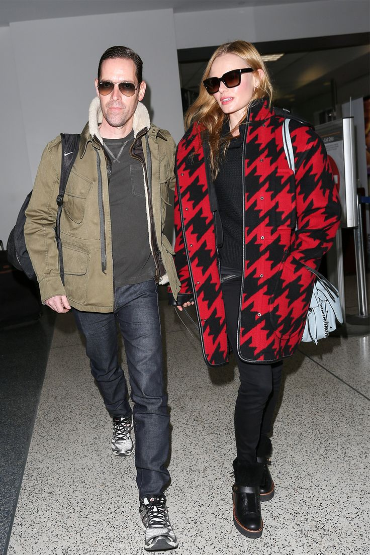 Complementary outerwear? Check! Touching down at LAX, Bosworth wore a Coach houndstooth parka, dark jeans, and Coach boots, while Polish opted for an army-green jacket, jeans, and sneakers.Coach Wool Houndstooth Parka, $1,039, available at Coach; Coach Urban Hiker Boots, $395, available at Coach.