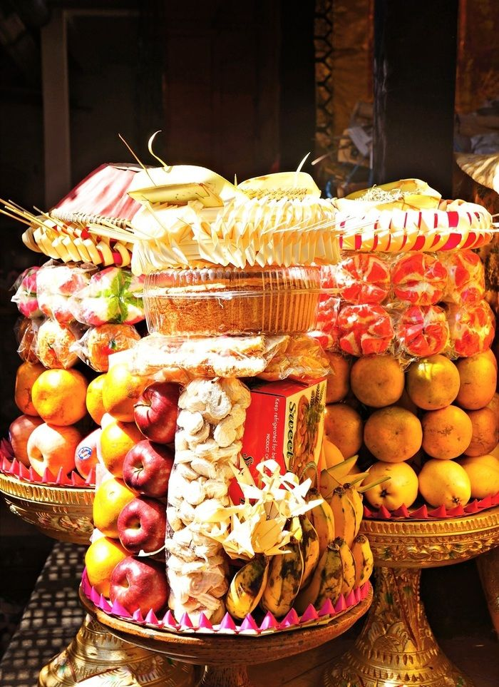 Lavish offerings: Fresh fruit and boxed snacks are some of the key ingredients of these appealing offerings. (Photo by Raditya Margi)