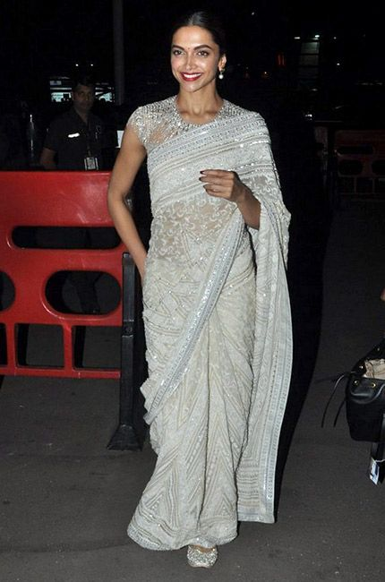 Deepika Padukone is one busy woman. This week, the star bagged an award and hopped onto a plane to Toronto in the same night. And what's more, she did the whole thing dressed impeccably in an ivory Abu Jani & Sandeep Khosla sari. She wasn't the only star who went the refined route. It was all …