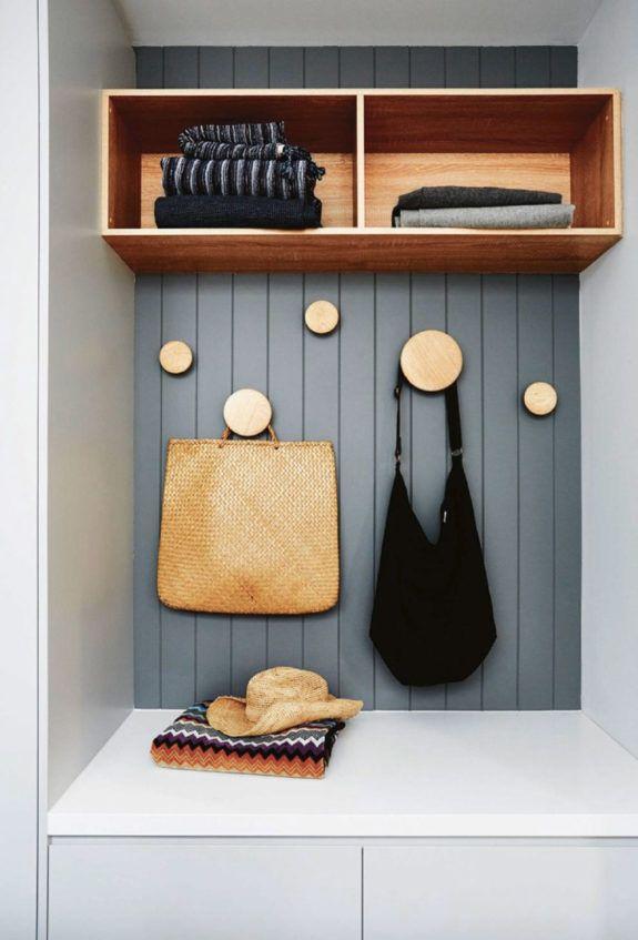 built-in storage in entryway with wood polka-dot hooks. / sfgirlbybay