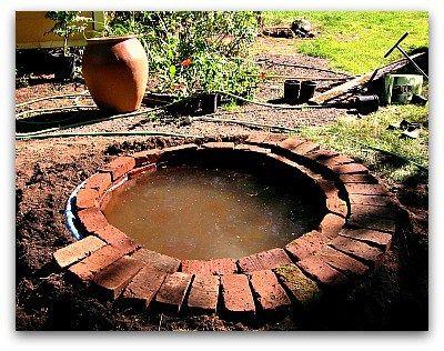 Brick lined fountain pool diy garden dreams pinterest for Koi pond plastic pool