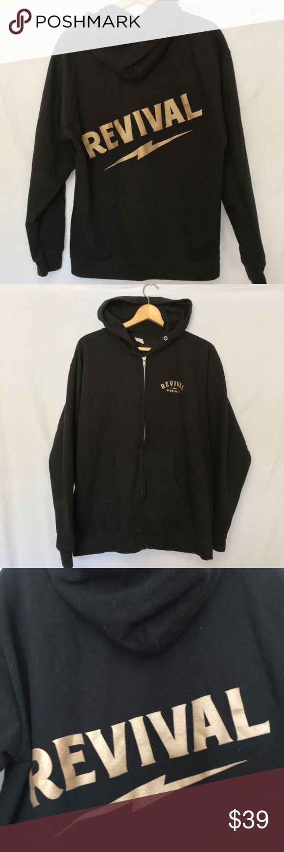 """Revival Brewing Co Beer Rhode Island Zip Hoodie Revival Brewing Co Beer Rhode Island Black Zip Sweatshirt Hoodie Mens Large Purchased at Brewtopia  80% Cotton & 20% Polyester Graphics are in a bronze metallic.  LENGTH 27"""" SLEEVES 27"""" UNDERARM TO UNDERARM 23"""" Good condition- missing pull string for hood and some very light wash wear.   Quick shipping! WE SHIP EITHER THE SAME BUSINESS DAY OR NEXT. ORDERS ON WEEKENDS ARE IN MAIL BY MONDAY MORNING. Shirts Sweatshirts & Hoodies"""