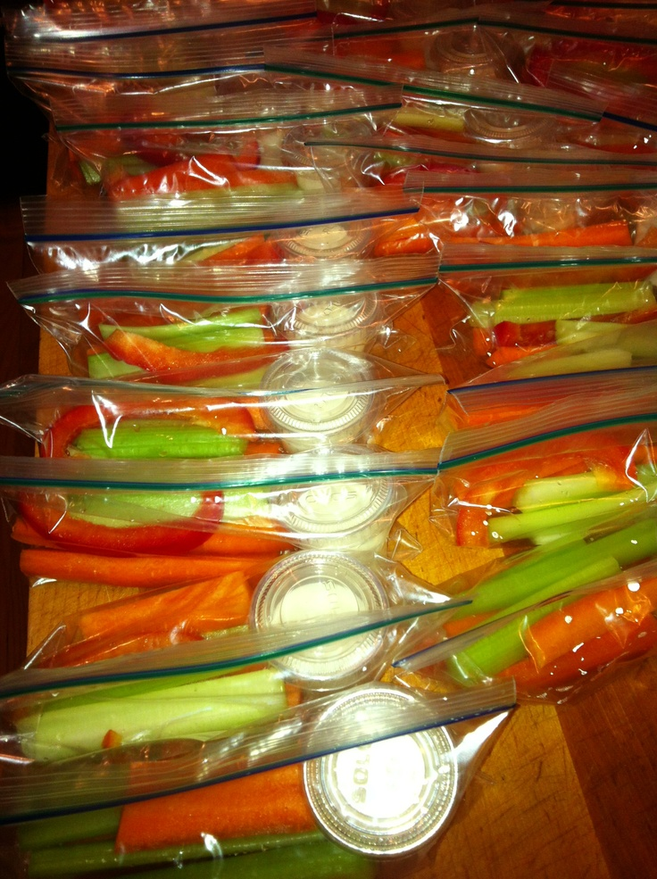 Healthy school snack! 1.25 oz plastic cups filled with ranch dressing served with organic veggies in a snack size ziploc bag. You can get these cups and lids at party city.  Use any combination of vegetables and dressing you prefer.