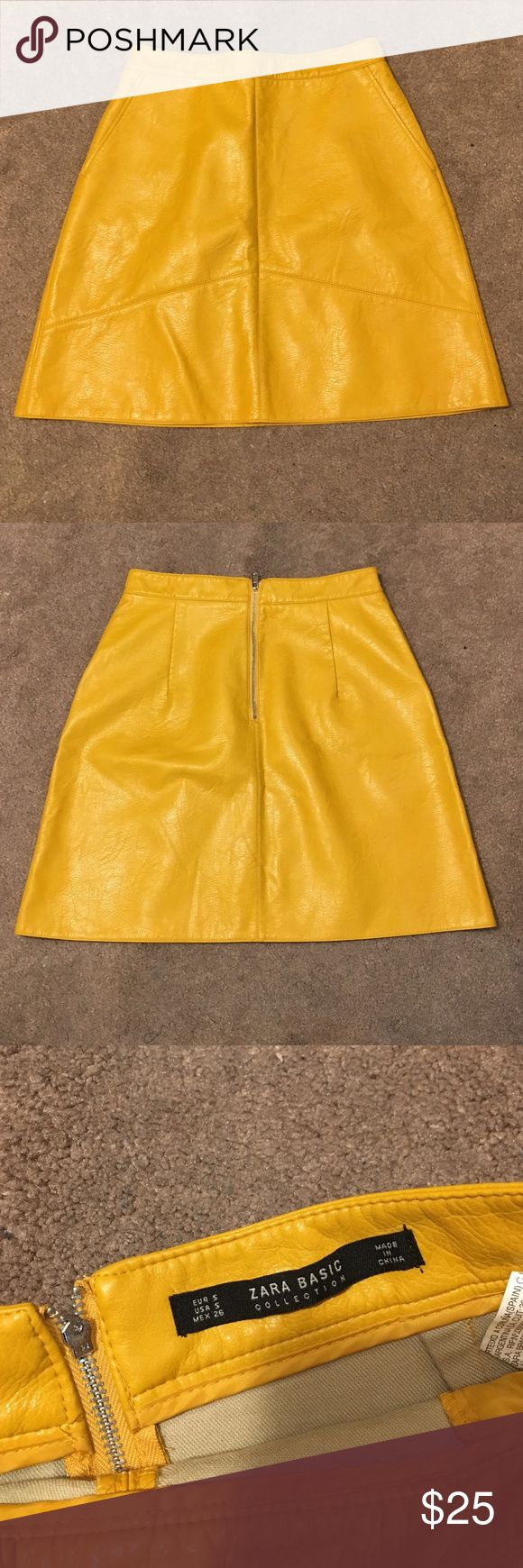 "Zara Mustard Yellow Faux Leather Skirt Faux leather mustard yellow skirt with two side pockets and back zip. Size small. Waist 28"". Length 18"". In great condition. Zara Skirts"