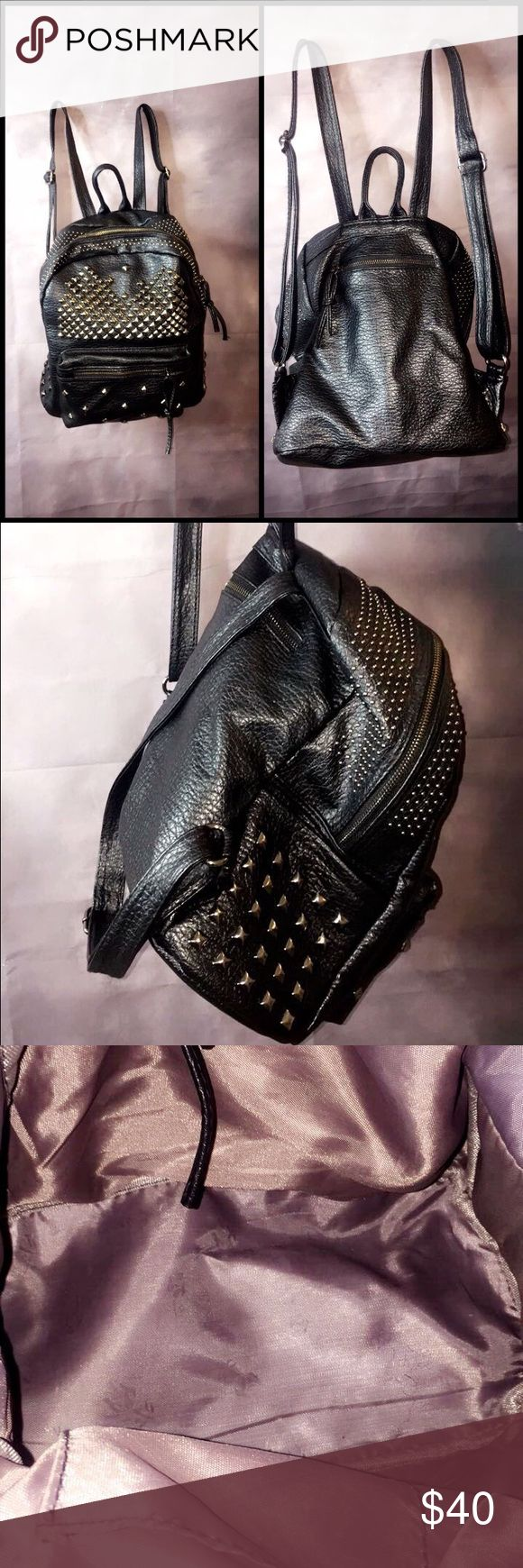 Black leather studded backpack Great quality very sturdy and spacious backpack great for school, travel or as purse. Medium sized. Compartments on both sides and zipper in the back back Bags Backpacks