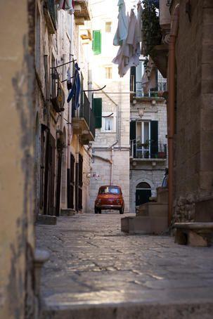 Giovinazzo Vecchio, Italy  Fiat 500 Bambino car in back streets of Giovinazzo Vecchio (old town).