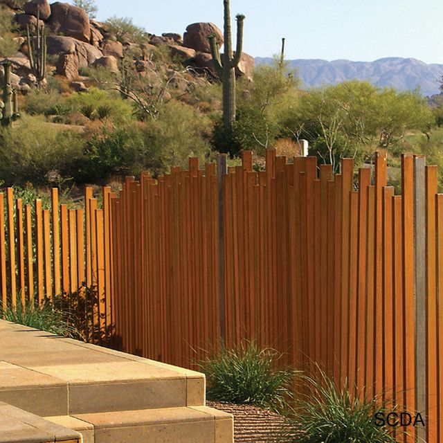 Rear fence line to have wide sleeper posts at varying height levels similar to Kingston