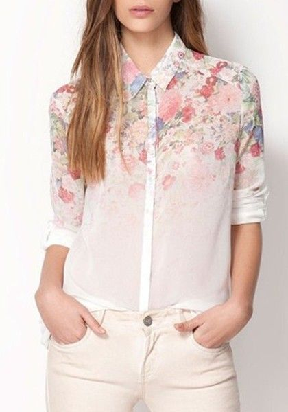 This gorgeous long sleeved blouse features crisp white chiffon with a delicate floral print .