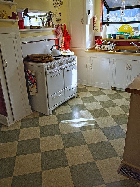 A retro-styled kitchen, goes with the dining nook picture, all with the VCT checkered floor tile.