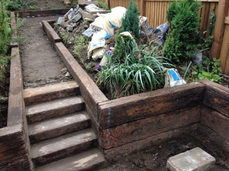 Used railway sleepers form steps and wall