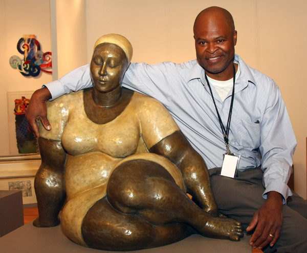 Artist Nnamdi Okonkwo with one of his works of art