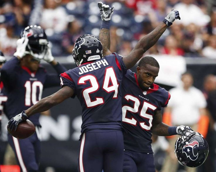 Houston Texans cornerback Johnathan Joseph (24) and defensive back Kareem Jackson (25) celebrate Joseph's interception of a pass by Cleveland Browns quarterback Kevin Hogan during the second quarter of an NFL football game at NRG Stadium on Sunday, Oct. 15, 2017, in Houston. Photo: Brett Coomer, Houston Chronicle / © 2017 Houston Chronicle
