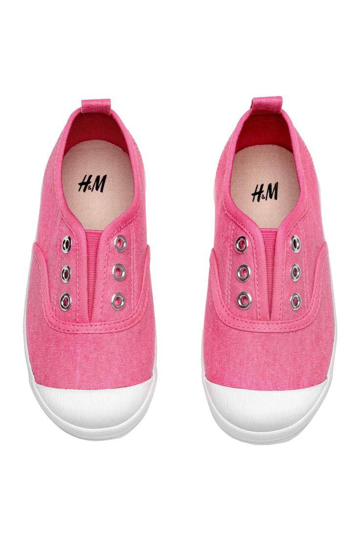 Buty sportowe z bawełnianego płótna. Z przodu kryta elastyczna wstawka, gumowe czubki palców, pętelka z tyłu. Tekstylne podeszwy wewnętrzne i gumowe podeszw