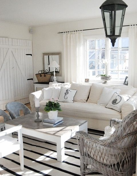 Simple beachy chic decor...love the non traditional black, white and gray color palette. I DO NOT like the barn doors however...