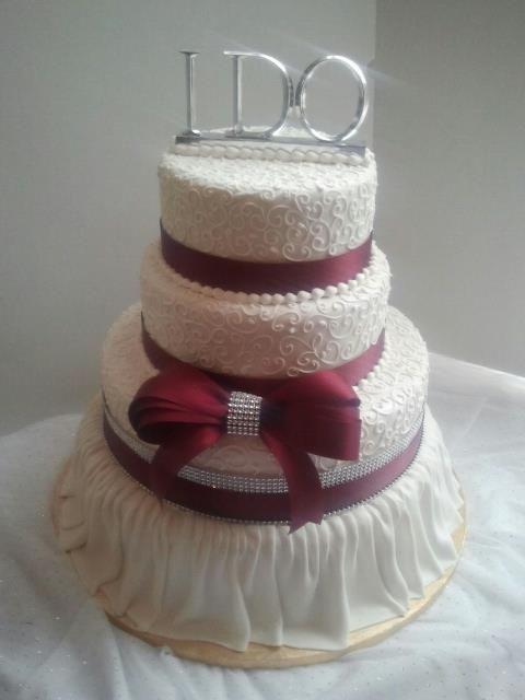 Fondant Skirt On Bottom Tier Of Wedding Cake