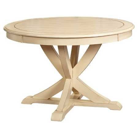 The Farmhouse Round Dining Table has that expertly crafted look that brings to mind country artisans. This dinner table has a pedestal base and decorative supports that make a pleasing X shape. The round shape of the kitchen table encourages conversation at dinners and is perfect for family game night.