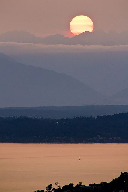 Sunset over Puget Sound. In the distance there is the Olympic Peninsula with the Olympic Mountains.