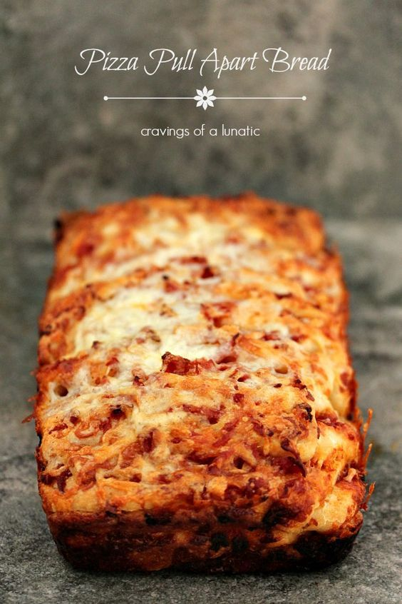 Pizza Pull Apart Bread from cravingsofalunati...- Easy and delicious pizza pull apart bread. This is great for lunch dinner or a party appetizer. The more cheese the better. (Cravings of a Lunatic)