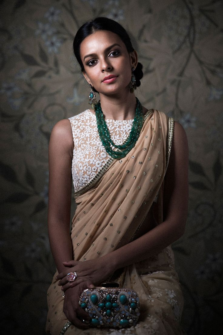 Peach embellished #Saree With White Embroidered#Blouse. What to wear to an Indian wedding. #clutch #EmeraldNecklace