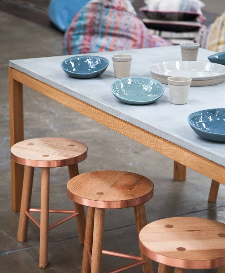 Styling is a bit like cooking - start with good ingredients and you're almost guaranteed a win. Add together copper trimmed stools matt/gloss combo ceramics concrete table and tableware and beautiful warm timber for a strong table game! #koskela