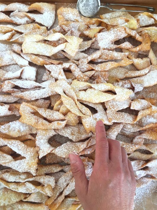 Known as Chiacchiere, Frappe, Cenci.. (and other names too). Fried pastries traditional during Carnival time in Italy.