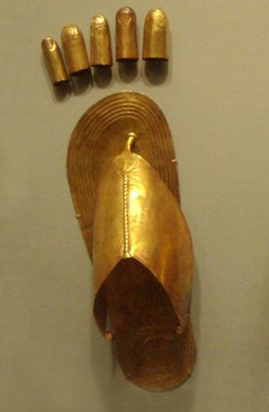 Egyptian Sheet gold finger and toe coverings, plus sandals, from the tomb of three minor wives of Thutmose III at Wady Gabbanat el-Qurud, circa 1479-1425 B.C. On display at the Metropolitan Museum of Art.