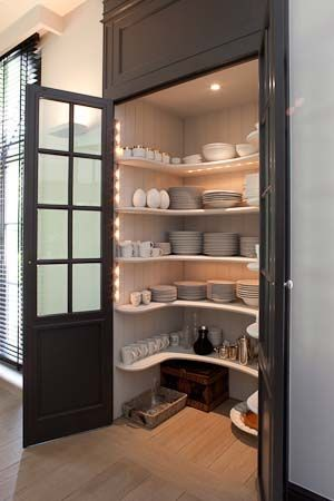 small walk-in pantry with double-door access.