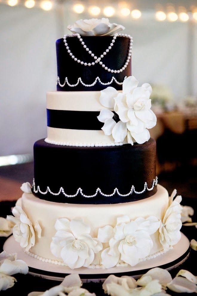 elegante vierstufige hochzeitstorte in schwarz und weiß