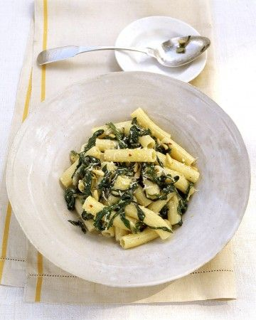 Swiss chard is sauteed with garlic, shallots, and lemon zest, and then allowed to simmer in white wine until tender. Tossed with creamy ricotta cheese and pine nuts, this is a satisfying vegetarian pasta dish.