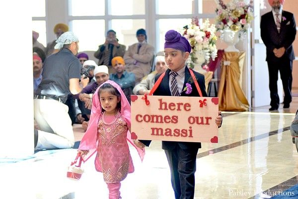 This traditional Sikh wedding includes a fun introduction for the bride at the ceremony.