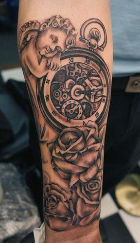 cherub and time piece tattoo