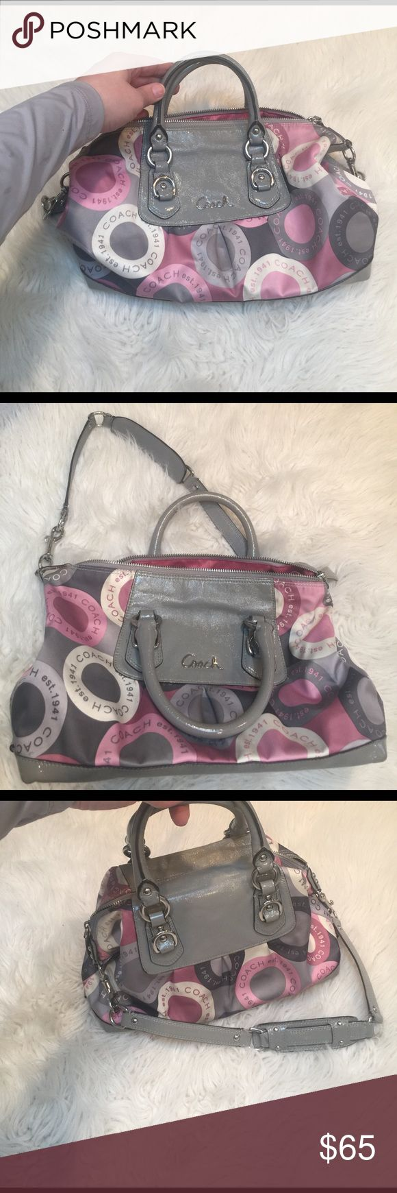 Authentic Coach purse. Gray patent leather/ satin Authentic Coach purse. Gray Patton leather with beautiful pink silk. Some wear, and pen marks. Could use a good cleaning. I don't know if her professional could remove the spots and marks. Price reflects cleaning. Coach Bags Shoulder Bags
