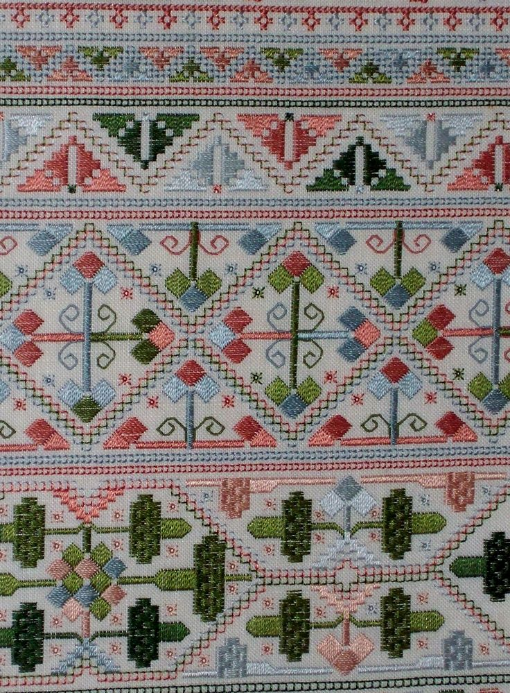 Close up of work on Joane Wallwin Sampler. This sampler was featured in Samplers and Antique Needlework Quarterly Magazine.