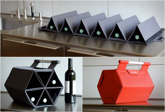 Wine Carrier - I don't know why I would need to carry 6 bottles around at once, but it looks so cool!