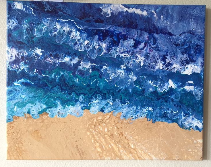 Acrylic pour tide with blue waves crashing onto