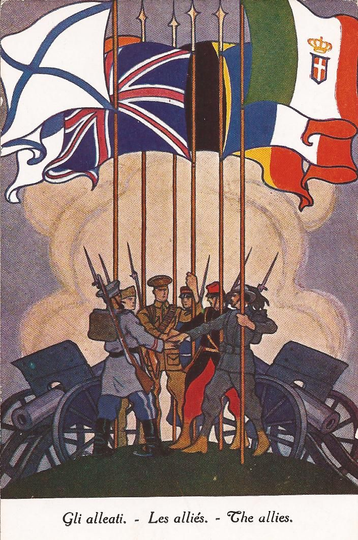 The Allies. From left to right, the flags are: Russia, Serbia, Great Britain, Belgium, France and Italy. As Italy entered the War in May 1915 and the United States in April 1917, we can suppose this postcard was published between the second half of 1915 and 1916.