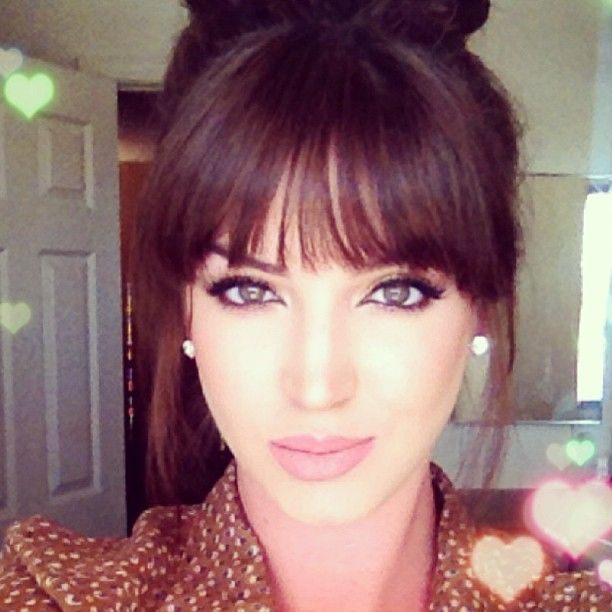 Thinking about cutting my bangs back to this style...  Decisions decisions...