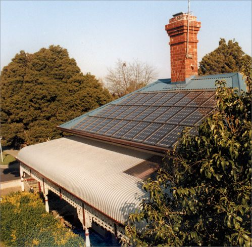 A large set of solar panels installed on the roof of a federation-style house.
