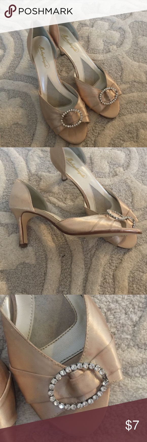 Champagne colored heels Worn at a wedding.  One stone missing on left shoe (as shown in photo). michaelangelo Shoes Heels